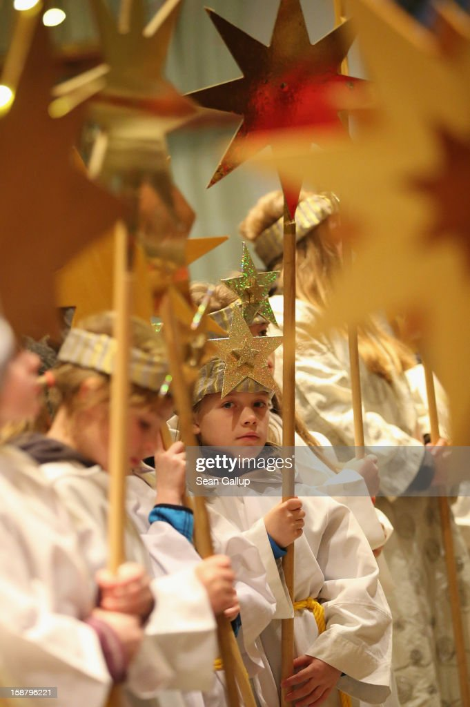 Children Epiphany carolers, in German called Sternsinger and dressed as the three kings Balthasar, Melchior and Gaspar, attend a religious mass ahead of their annual charity donation collection drive on December 29, 2012 in Berlin, Germany. The children will walk house to house in the days around January 6, singing carols and collecting money for needy children across the globe.