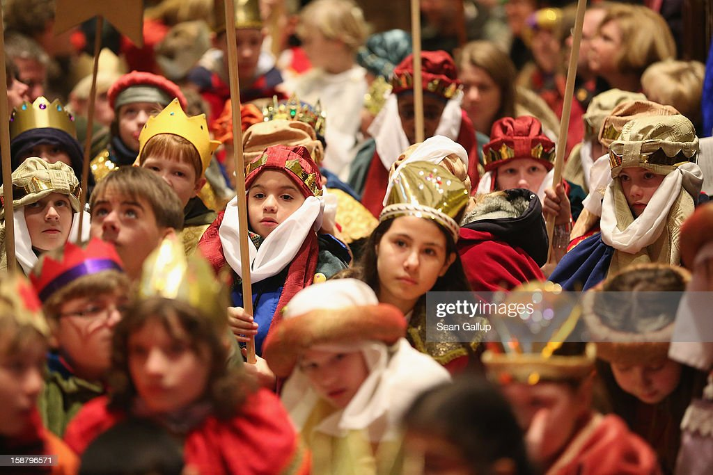 Children Epiphany carolers, in German called Sternsinger, dressed as the three kings Balthasar, Melchior and Gaspar attend a religious mass ahead of their annual charity donation collection drive on December 29, 2012 in Berlin, Germany. The children will walk house to house in the days around January 6, singing carols and collecting money for needy children across the globe.