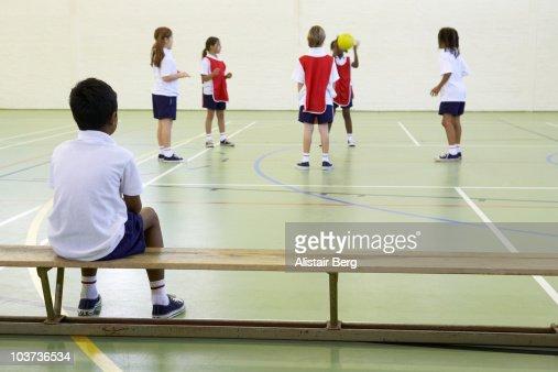 Children exercising in gymnasium