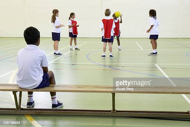 Children exercising in gymnasium