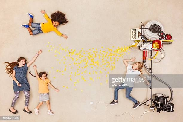 Children experimenting with new money machine