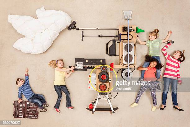 Children experimenting with new weather machine