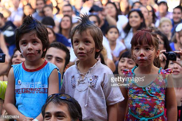 Children fans '31 minutos' participate in the Lollapalooza music festival at O Higgins Park on March 31 2012 in Santiago Chile