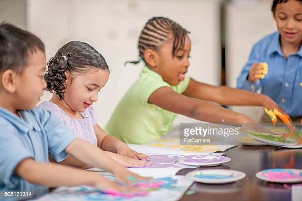 Children Finger Painting in Art Class