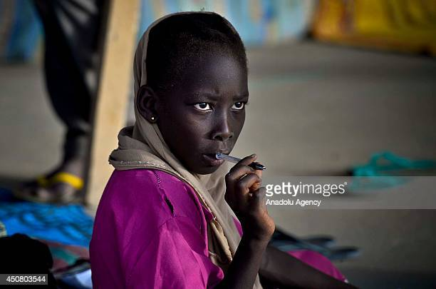 N'DJAMENA CHAD JUNE 17 Children fled from Central African Republis's Bangui to Chad attend a class in a madrasa at Gaui refugee camp which is Chad's...