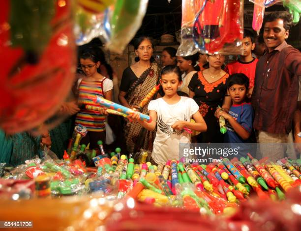 Children flock to shops in Citylight Market in Matunga selling holi colours and pichkaris to gear themselves for the festival of colours