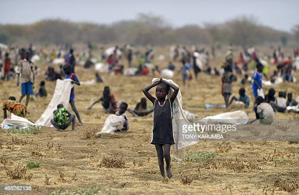 Children flock with containers to a field demarcated for fooddrops at a village in Nyal an administrative hub of Panyijar county in Unity state south...