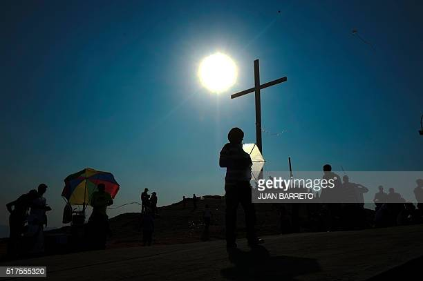 Children fly a kite before the procession for the Passion of Jesus Christ on Good Friday in the lowincome neighbourhood of Petare in Caracas...