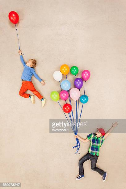 Children flying away on balloons