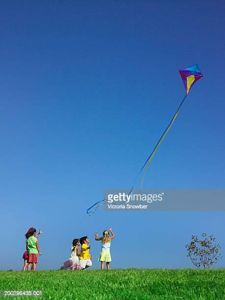 Children (4-6) flying kite