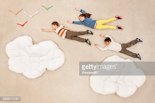 Children flying over clouds