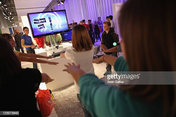 Children follow a PlayStation exercise regime at the Sony stand at the IFA 2011 consumer electonics and appliances trade fair on the first day of the...
