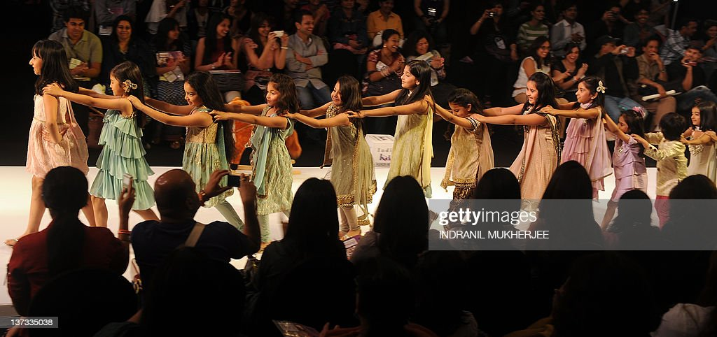 Children form a train as they walk on the ramp during the first India Kids Fashion Week (IKFW) in Mumbai on January 19, 2012. The 3 day-long IKFW, which has leading Indian designers and brands showcasing their designs is a one-of-a-kind initiative to give India's upcoming and high potential kids fashion segment, a boost. AFP PHOTO/ Indranil MUKHERJEE