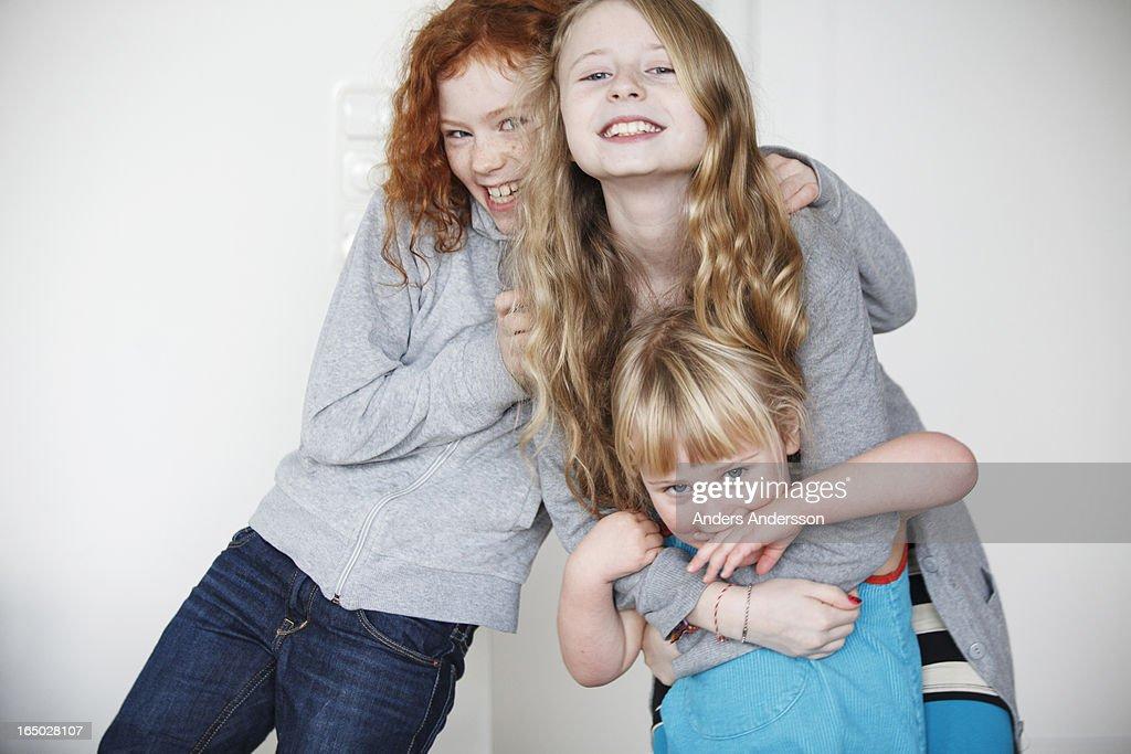 Children, friends hugging