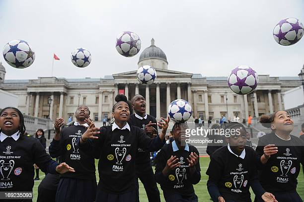 Children from a local school show off their heading skills during the Uefa Champions League Trophy Tour with adidas at Trafalgar Square on May 22...