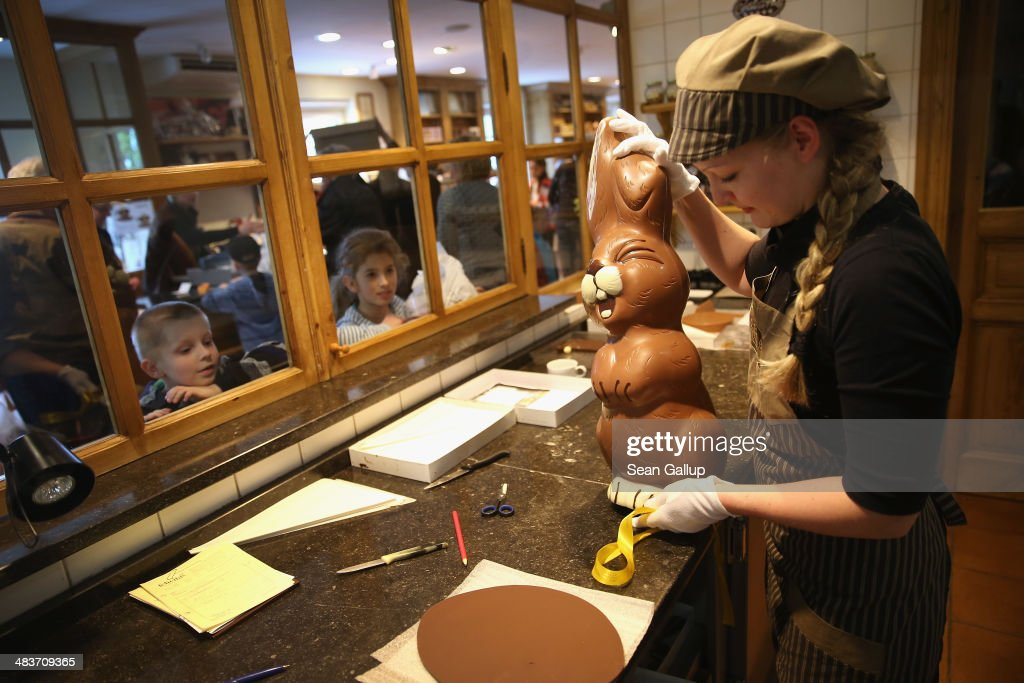 Children from a Polish tour group watch as employee Sandra Jaeckel prepares to take away a giant chocolate Easter bunny after showing it to them at Confiserie Felicitas chocolates maker on April 9, 2014 in Hornow, Germany. Easter is among the busiest times of year for the chocolatier, which produces Easter bunnies and eggs in a wide variety of sizes and styles. Founded by Belgian expats Goedele Matthyssen and Peter Bientsman the company will soon celebrate its 21st year.