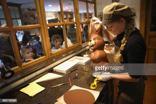 Children from a Polish tour group watch as employee Sandra Jaeckel prepares to take away a giant chocolate Easter bunny after showing it to them at...