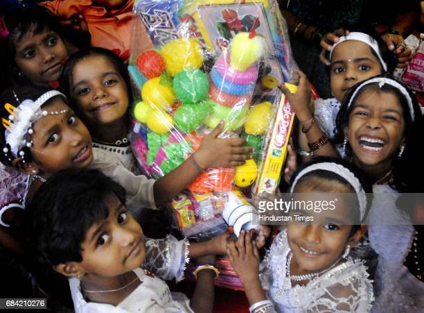 Children from Aanganwadi with their set of educational toys distributed at 'Joy in a Box' an yearly initaitive by 'Life Trust' NGO at a municipal...