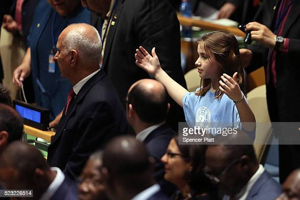 Children from around the world stand in a procession with world leaders and country delegates in the General Assembly Hall at the United Nations...