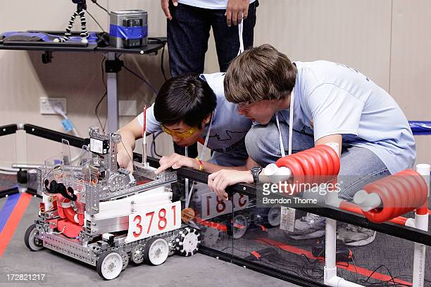 Children from Australia operate their robot at the LEGO Education FIRST Robot Games Tournament on July 5 2013 in Sydney Australia Over 50 teams 550...