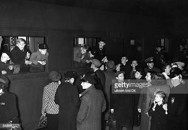 Children from Berlin taking part in a holiday camp in the east organized by the NSV at the railway station with their parents 1940 Photographer...