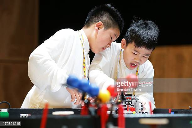 Children from China operate their robot at the LEGO Education FIRST Robot Games Tournament on July 5 2013 in Sydney Australia Over 50 teams 550...