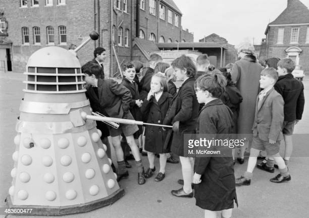 Children from Dr Barnardo's greeting a Dalek a nemesis of Dr Who in the BBC television series 4th February 1964