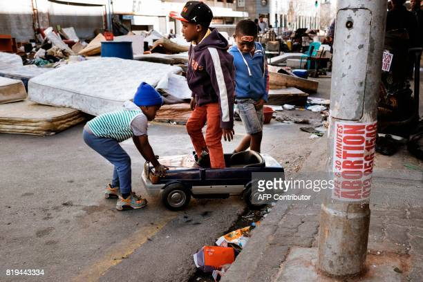 TOPSHOT Children from Fattis Mansion in downtown Johannesburg who were evicted the day before during a Red Ants operation a municipal team tasked...