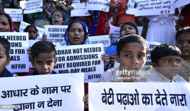 Children from government school protest at Shastri Bhawan against making Aadhar card mandatory for midday meal on March 17 2017 in New Delhi India...