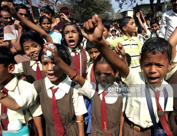 Children from Gyanprakash vidyalaya stage a rasta roko on Wednesday after an iron rod fell and seriously injured a 9 year old girl