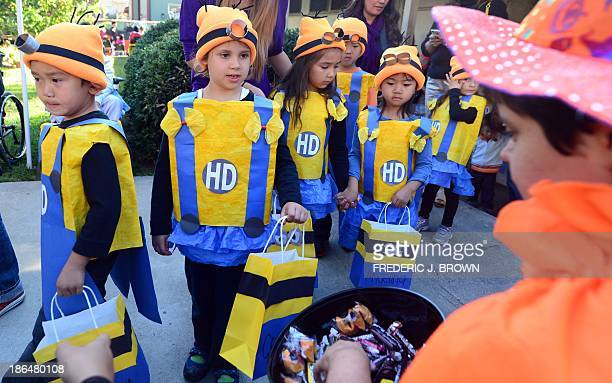 Children from Happy Day School in Monterey Park California dress as Minions celebrate Halloween on October 31 2013 by going trick or treating at a...