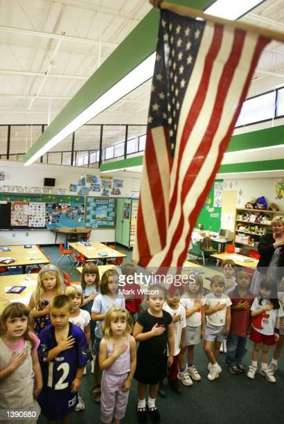 Children from Mrs Morrow's kindergarden class at Sunderland Elementry school recite the Pledge of Allegiance September 17 2002 in Sunderland Maryland...