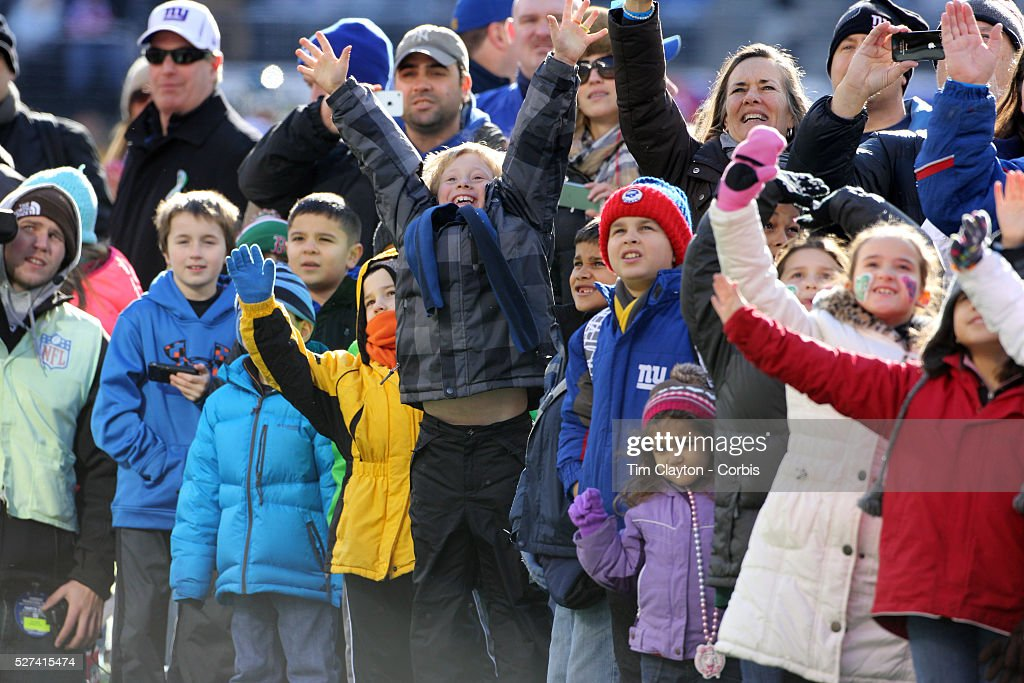 Children from Sandy Hook Elementary School react to seeing themselves on the big screen as they form a guard of honor for the New York Giants before...