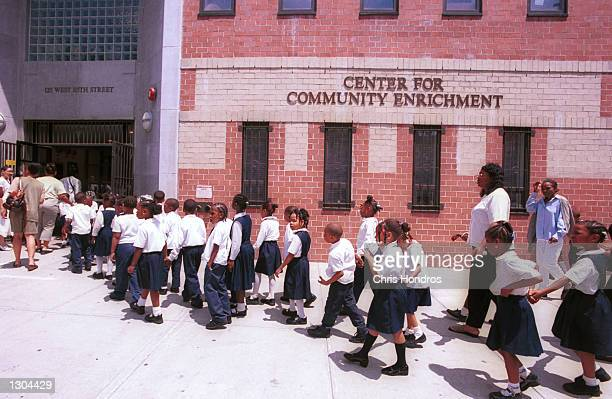 Children from Sisulu Children''s Adademy a Harlem charter school stream into their rented building at a community center Jun 21 2000 in New York City...
