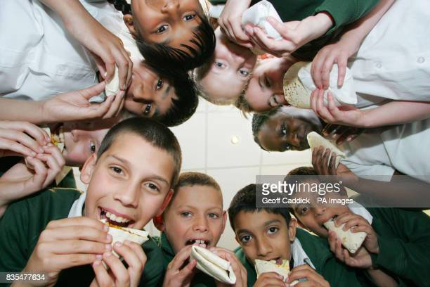 Children from St Mary's Church of England Primary School in Slough during a school visit to The Healthy Takeaway a food outlet in Slough Berkshire...