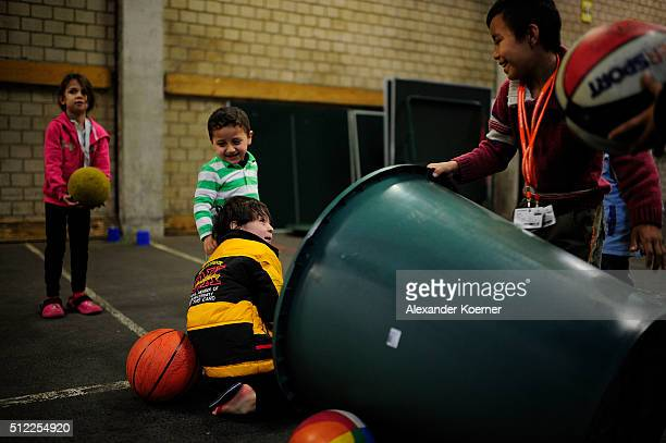 Children from Syria and Afghanistan play at a makeshift playground inside a shelter where they live while their asylum applications are processed on...