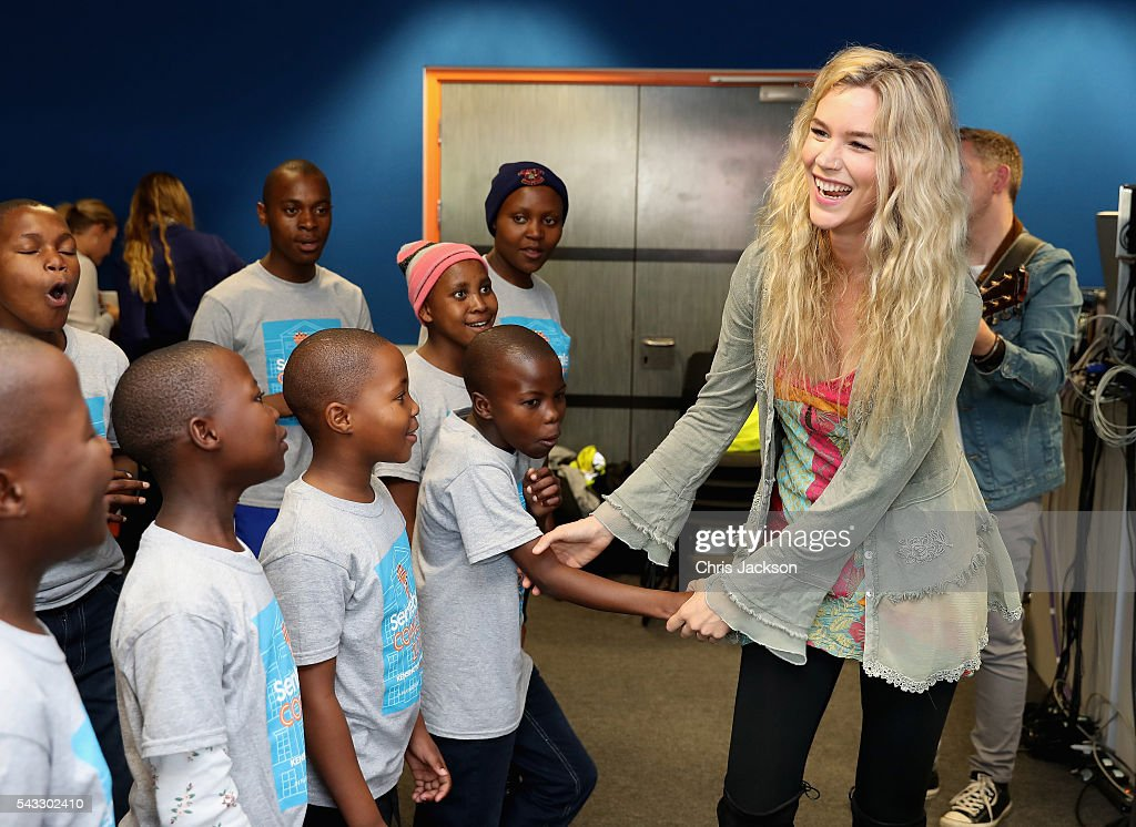 Children from the Basotho Youth Choir, made up of six boys and six girls, aged between 7 and 19 years old, joke around with <a gi-track='captionPersonalityLinkClicked' href=/galleries/search?phrase=Joss+Stone&family=editorial&specificpeople=201922 ng-click='$event.stopPropagation()'>Joss Stone</a> as they rehearse at the Brit School on June 27, 2016 in London, England. The Basotho Youth Choir will perform alongside Sentebale Ambassador <a gi-track='captionPersonalityLinkClicked' href=/galleries/search?phrase=Joss+Stone&family=editorial&specificpeople=201922 ng-click='$event.stopPropagation()'>Joss Stone</a> at tomorrow's Sentebale Concert at Kensington Palace, headlined by Coldplay. The choir members have all been supported by Sentebale's Secondary School Bursaries Progamme or Care for Vulnerable Children Programme. The Bursaries Programme covers the cost of school fees, uniforms and books for some of Lesotho's most disadvantaged children.