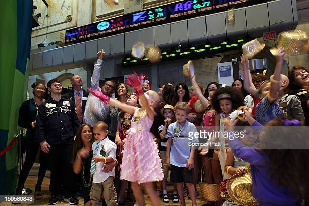 Children from the childhood cancer foundation Candlelighters NYC walk on the floor of the New York Stock Exchange on August 21 2012 in New York City...