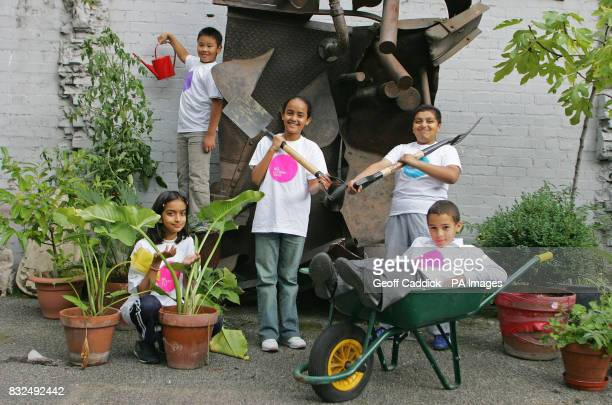 Children from the Clara Grant Primary School LeftRight Saba Qureshi Ngoc Pham at top with watering can Halima Khanam Azim Ahmed and Jaydon Sullivan...