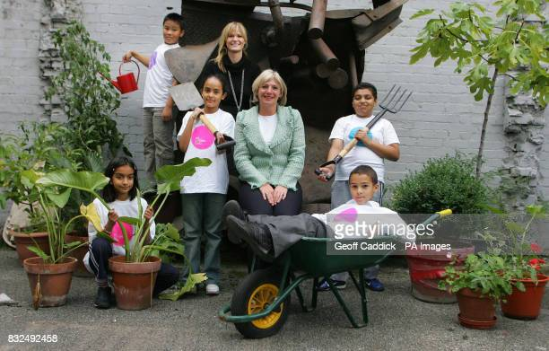 Children from the Clara Grant Primary School LeftRight Saba Qureshi Ngoc Pham at top with watering can Halima Khanam Annie Bicknellhead of Education...