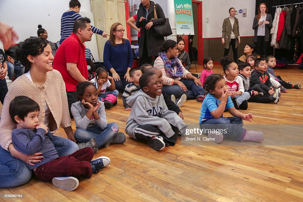 Children from the Garden of Dreams Foundation watch as Cookie Monster and Elmo perform during the Sesame Street Live Dance Class held at Ripley Greer Studios on February 10, 2016 in New York City.