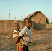 Children from the poor village of Dildo Chad whose inhabitants have been compensated by Exxon Mobil for pipeline disturbance during the building of...