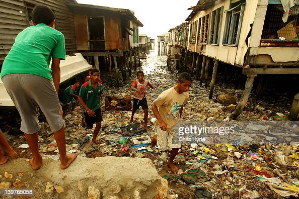 Children from the village of Hanuabada look for a lost ball during a game of cricket in the streets on February 24 2012 in Port Moresby Papua New...