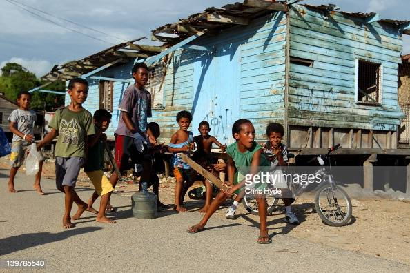 Children from the village of Hanuabada play cricket in the streets on February 24 2012 in Port Moresby Papua New Guinea