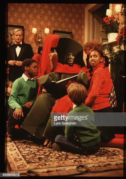 Children gather around Eddie Murphy performing as Gumby in a Christmas skit on Saturday Night Live