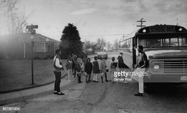 Children Gather at E 30th Ave and Cook St for the Bus Ride to Montclair Elementary School The youngsters are in the Barrett Elementary School area...