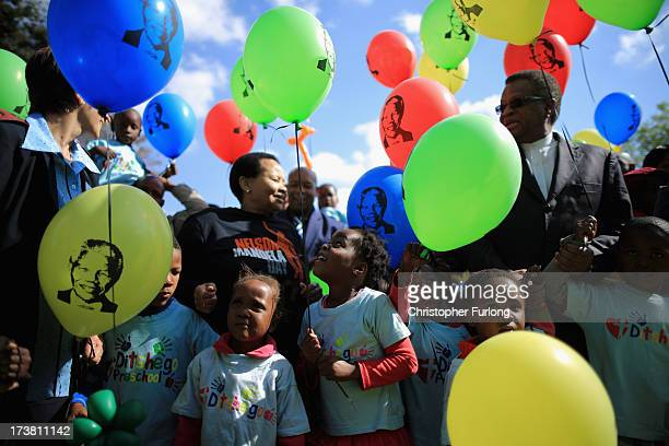 Children gather to celebrate the 95th birthday of their 'Father of the Nation' Nelson Mandela outside the Mediclinic Heart Hospital where he is being...