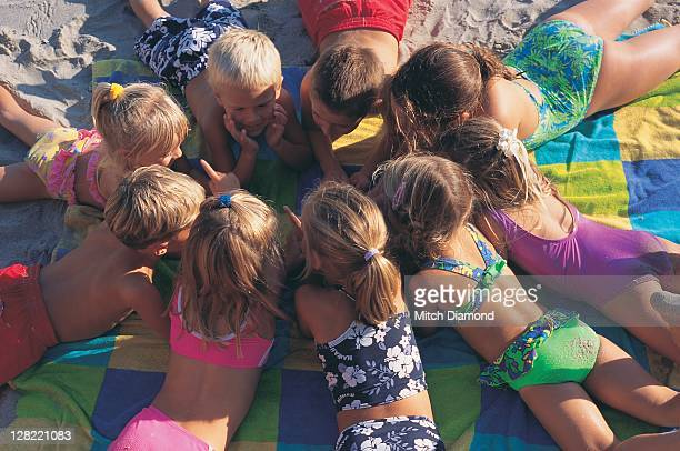 Children gathering on the sand