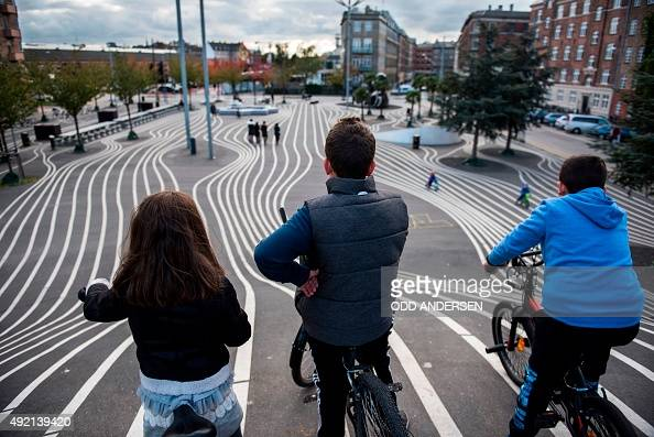 Children get ready to race down a steep hill painted with lines at a recreational area in Copenhagen's Norrebro neighbourhood on October 10 2015 AFP...