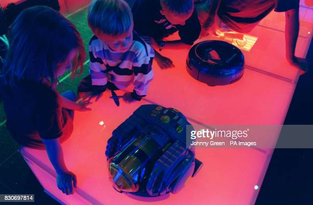 Children get to grips with the prototypes for the Electrolux Robovac and the Dyson DC06 as part of an exhibition celebrating the 100th anniversary of...